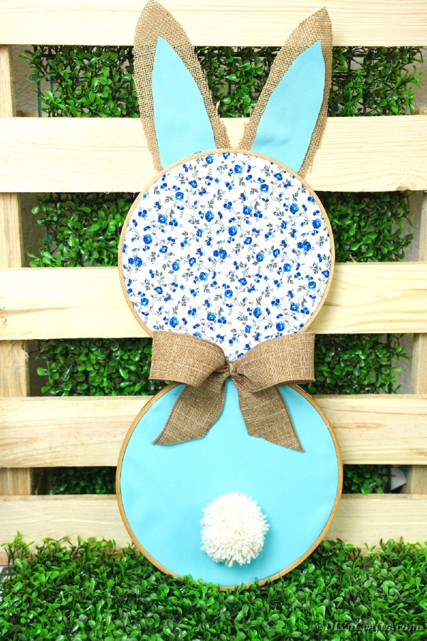 Fabric bunny wall art in front of pallet