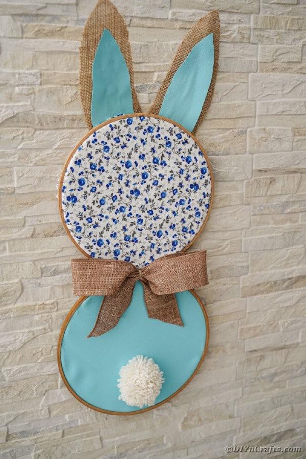 Bunny hanging on brick wall