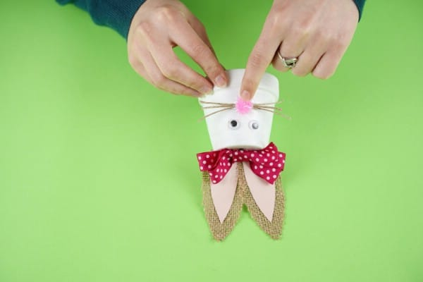 Gluing twine whiskers to bunny