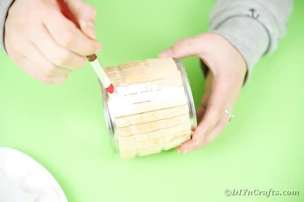 Painting clothespins on tin can