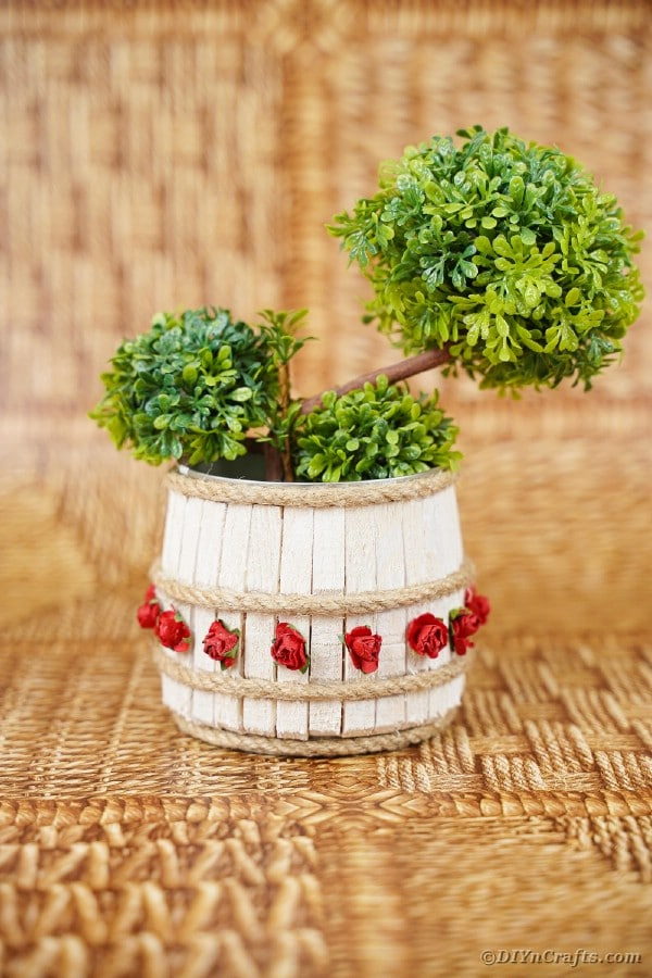 Clothespin organizer can with greenery inside