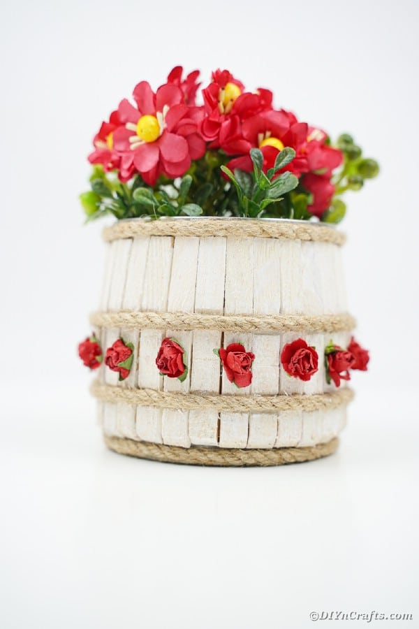 Mini barrel made from clothespins filled with red flower
