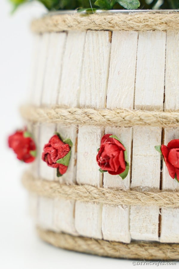 Clothespin covered tin can with red rose accent