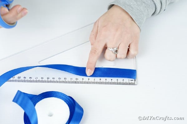 Measuring out blue ribbon