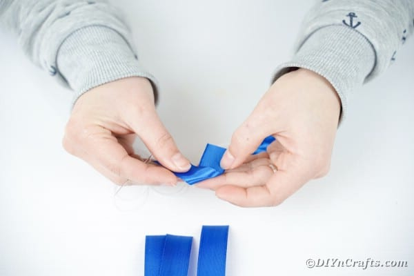 Folding blue ribbon