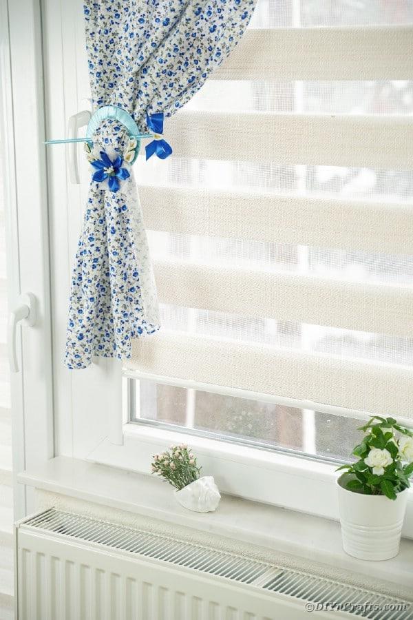 CD curtain holder on floral curtain