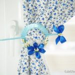 Blue cd curtain holder on blue foral cloth