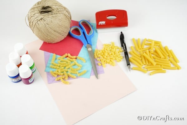 Supplies for making pasta easter egg garland