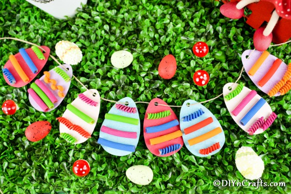 Paper egg garland laying on grass