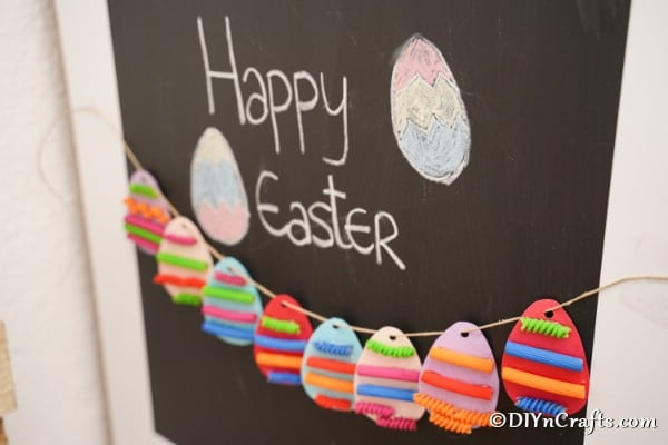 Pasta easter egg garland on chalkboard