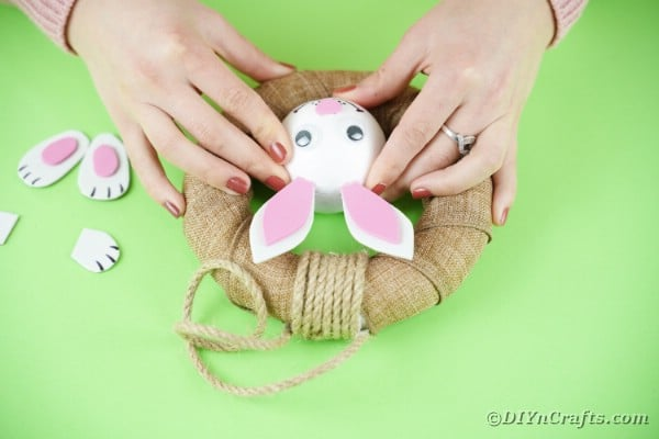 Gluing bunny head to wreath