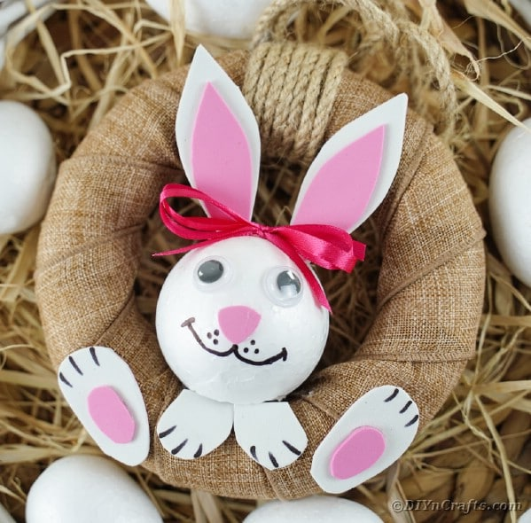 Easter bunny wreath on hay with eggs