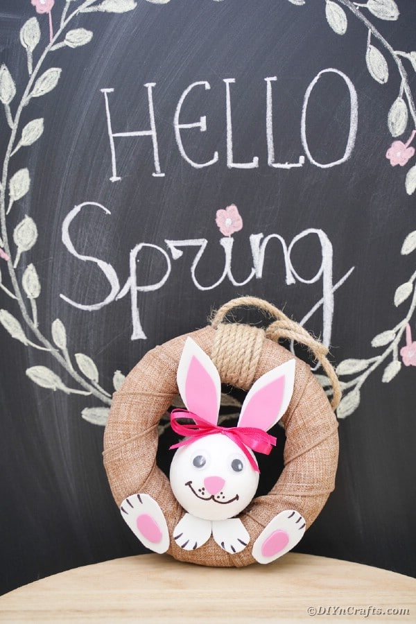 Easter bunny wreath in front of chalkboard