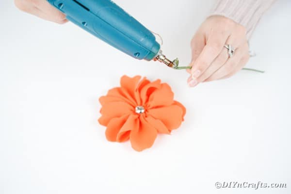 Gluing stem to a fabric flower