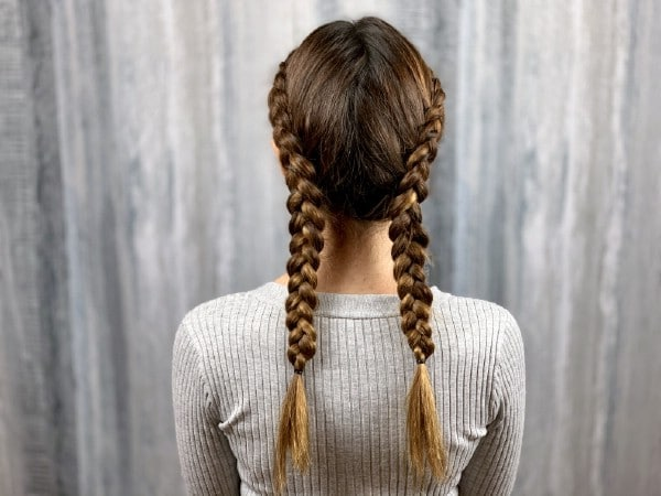 Back view of double dutch braids on brunette