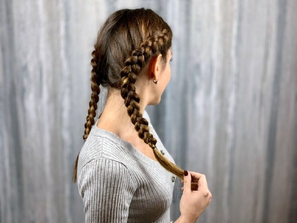 Brunette with grey shirt and double dutch braids