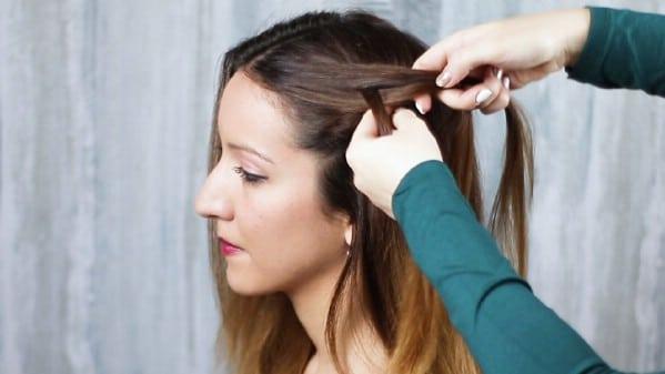 Braiding hair near forehead