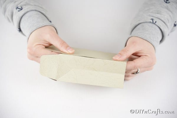 Folding paper bag together
