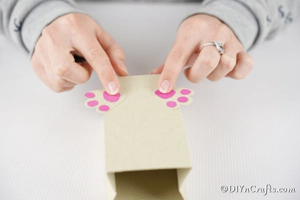 Attaching bunny feet to bag