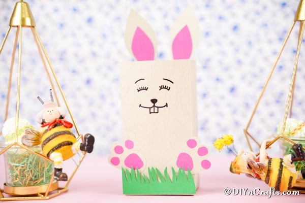 Easter paper bag candy holder in front of easter background