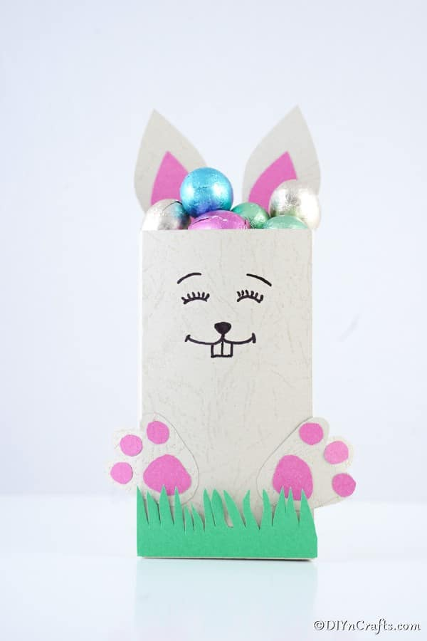 Paper bag Easter candy holder on white surface