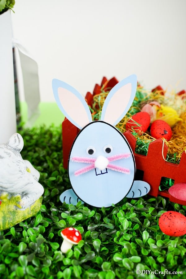 Egg shaped card on gake grass with Easter decor