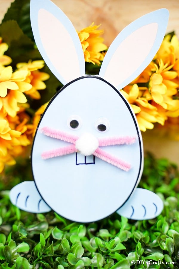 Easter bunny egg card on fake grass