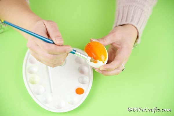 Painting egg orange