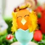 Chicken Easter egg in blue egg cup