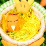 Chicken decorated egg in duck bowl