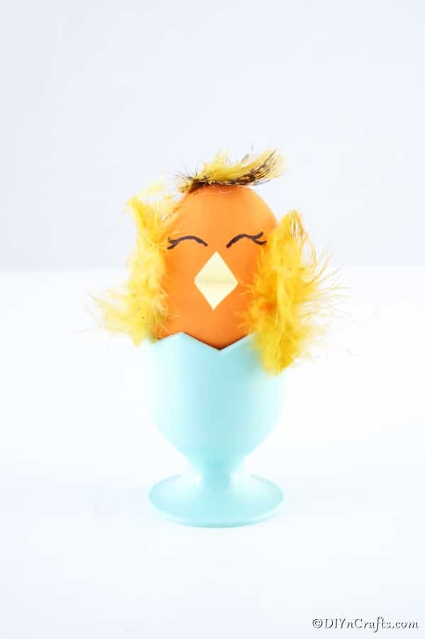 Chicken egg craft in blue egg cup