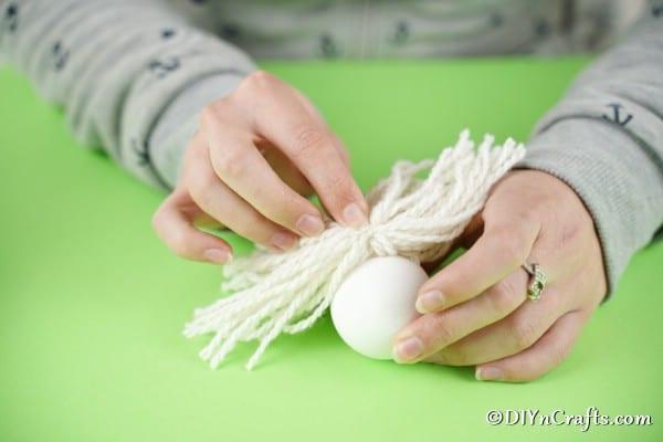 Attaching yarn beard to egg