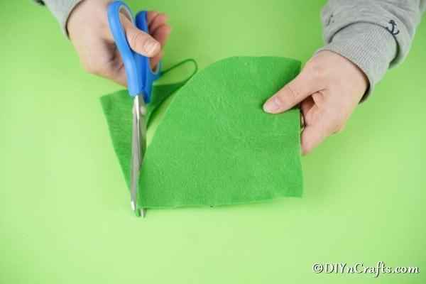 Cutting green felt hat