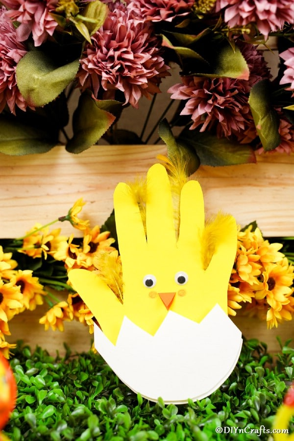 Chicken card in front of yellow flowers