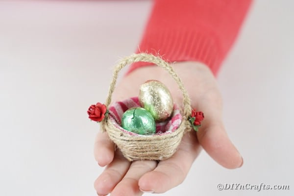 Mini easter basket in a womans hand
