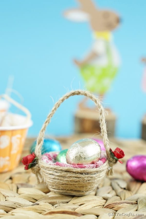Twine wrapped mini Easter basket on woven mat