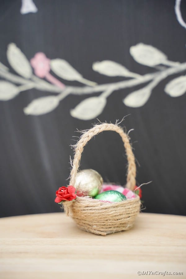 Egg crton basket in front of chalkboard