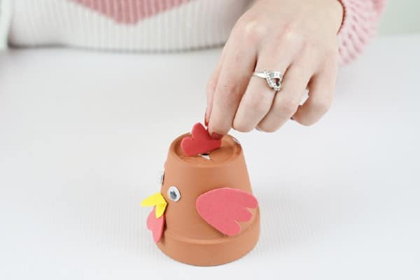 Gluing red top to flower pot chicken