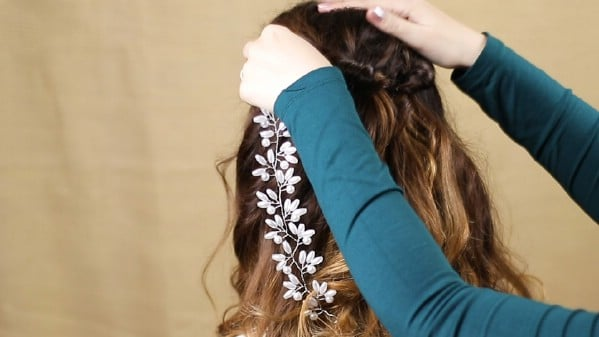 Adding beaded vine to half up half down hairstyle