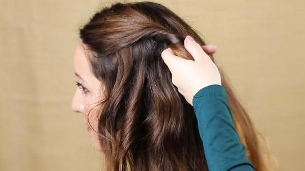 Twisting brunette hair