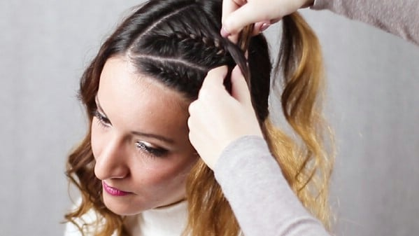 Braiding hair at front of scalp