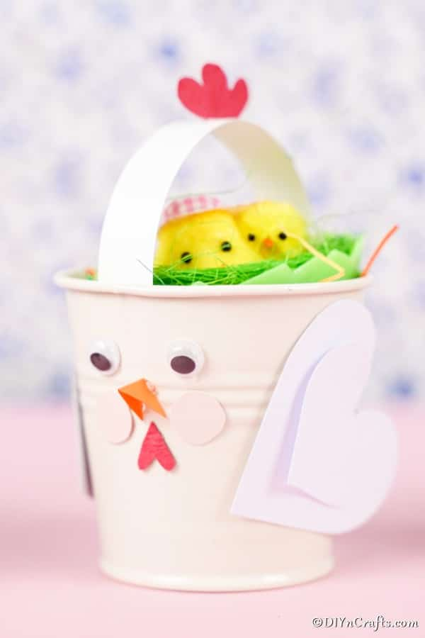 Easter chicken bucket on pink surface