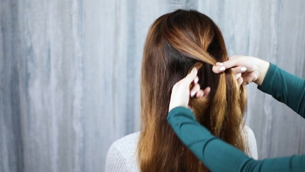Crossing hair over itself to braid