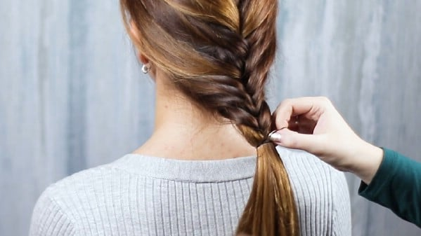 Securing braid with a hair tie