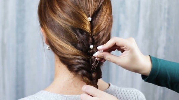 Adding hair pin accents to braid