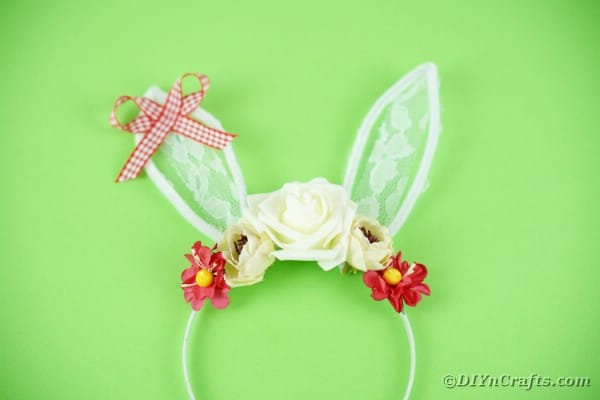 Lace Easter bunny ears headband on green table