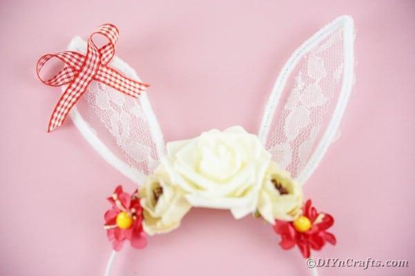 Bunny ears headband on pink surface