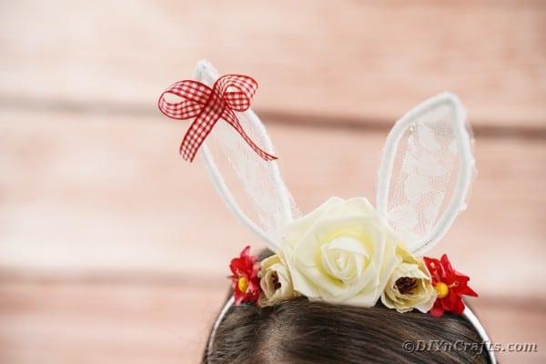 Lace bunny ears headband on brunette