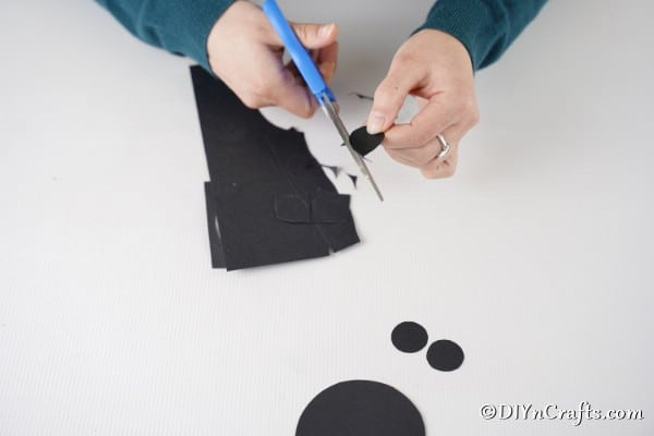 Cutting circles from black paper