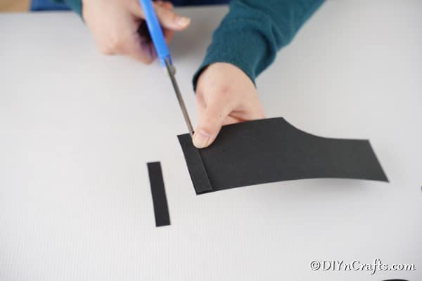 Cutting strips from black paper